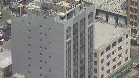 LAPD responds to shots fired report, man barricaded in DTLA building