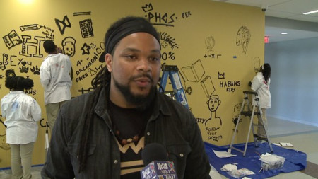 Popular graffiti artist brainstorms with students on mural for New Orleans charter school