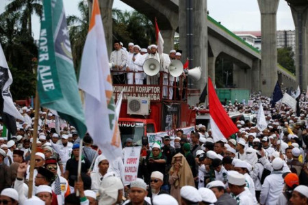 FPI leader Rizieq has agreed that his organization will not join Saturday protest march: Police
