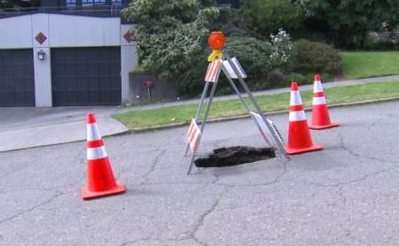'Apparent sinkhole' appears in Seattle; street closed
