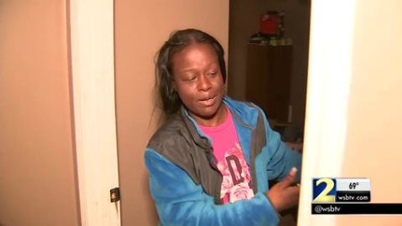 Woman fights off knife-wielding intruder
