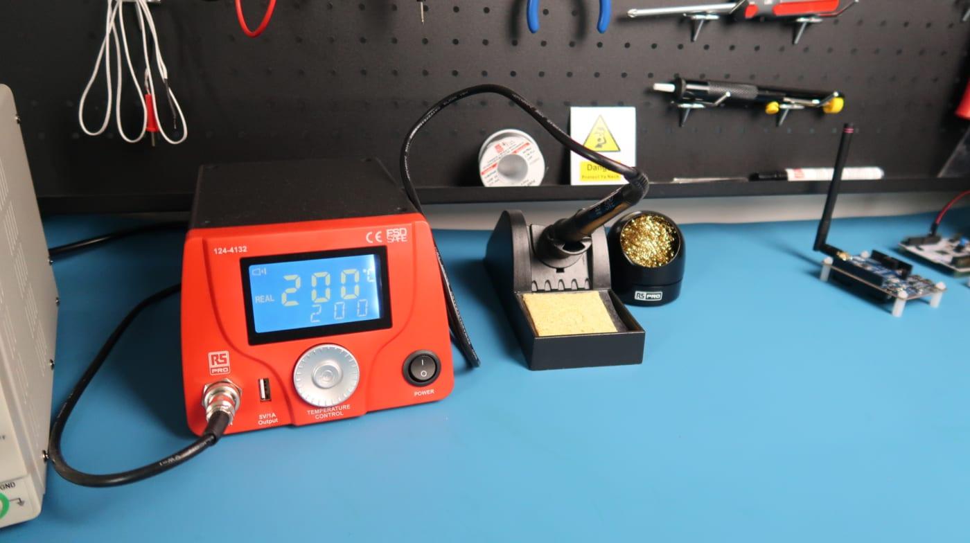 Soldering equipment including station