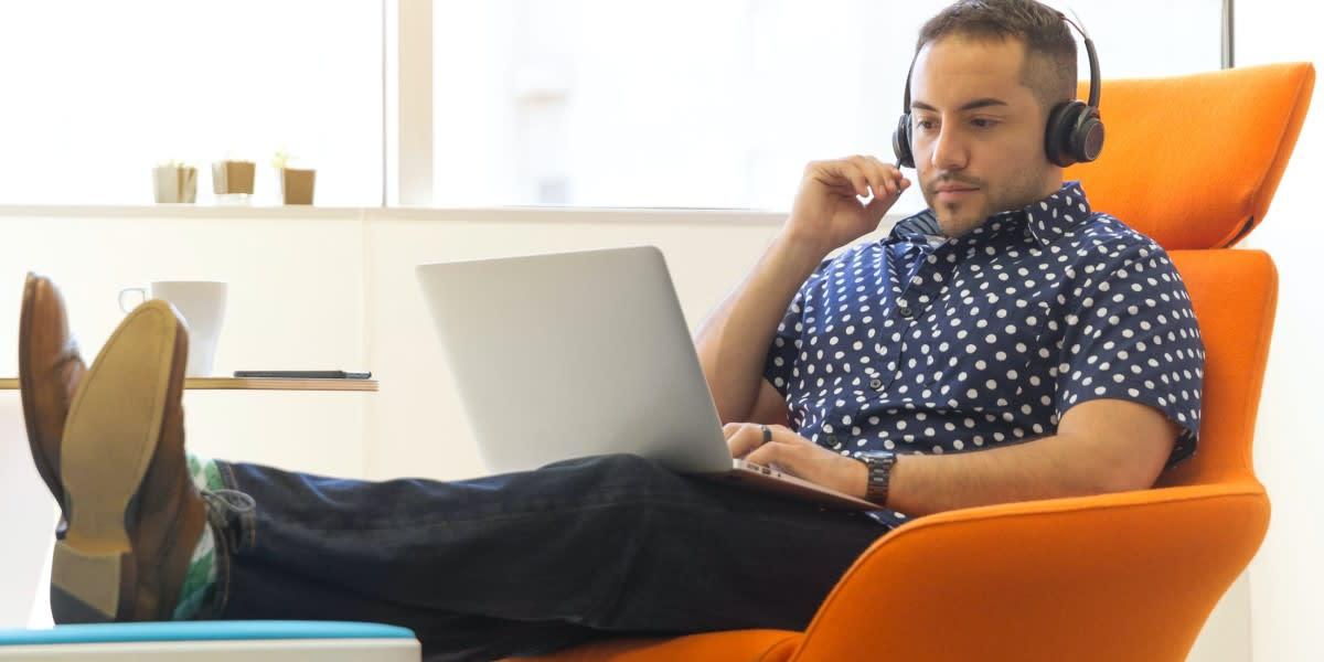man on a laptop - podcast analytics