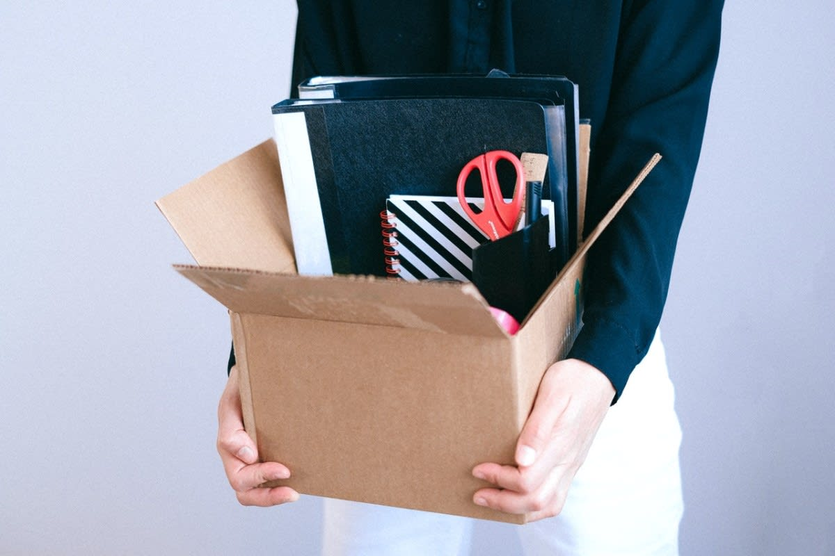 girl holding box of work supplies