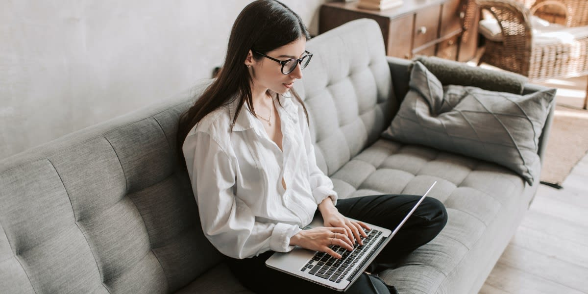 Podcast Needs An Email List Woman Typing On Laptop