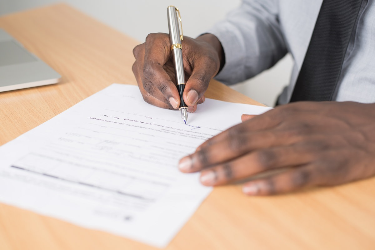 person signing a podcast release form