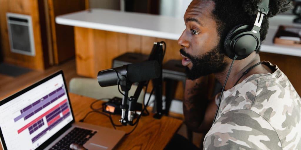 man recording a podcast
