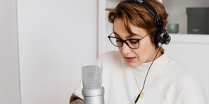 woman on podcast - how to score big guest interviews