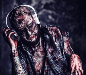 zombie wearing headphones - bring your podcast back from the dead