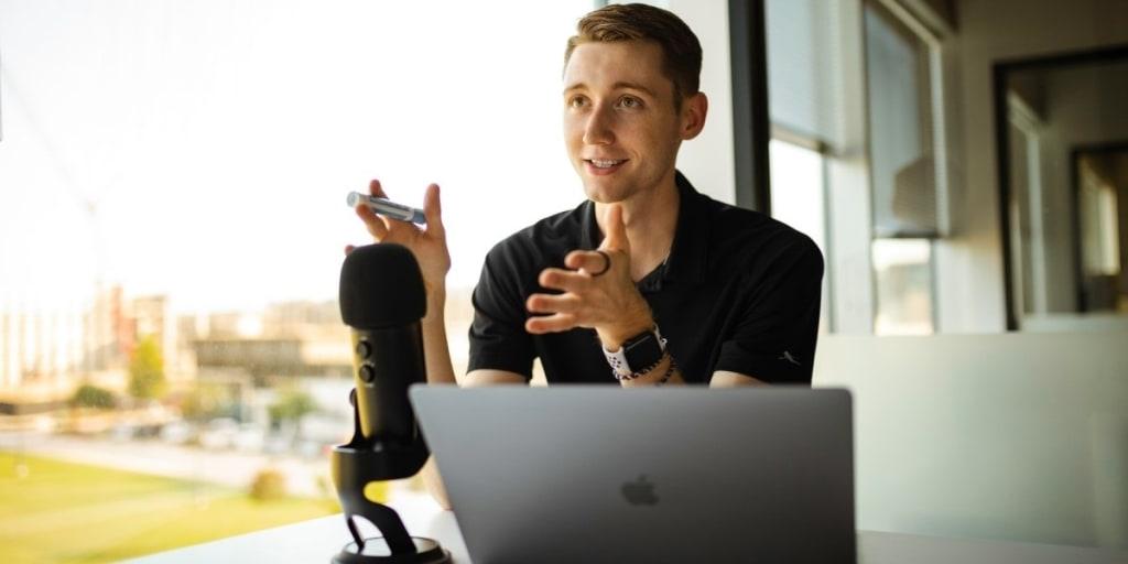 man having podcast