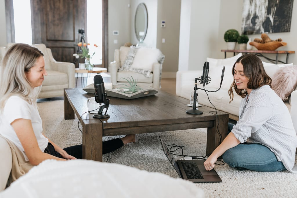 two women hosting a podcast