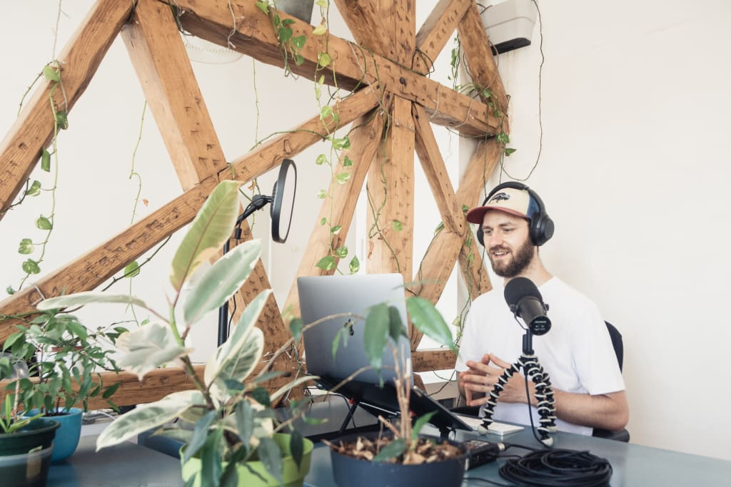 man running a podcast
