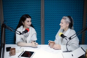 two women on a podcast
