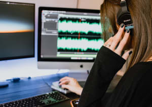 picture of woman editing a podcast