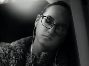 girl relaxing with headphones on