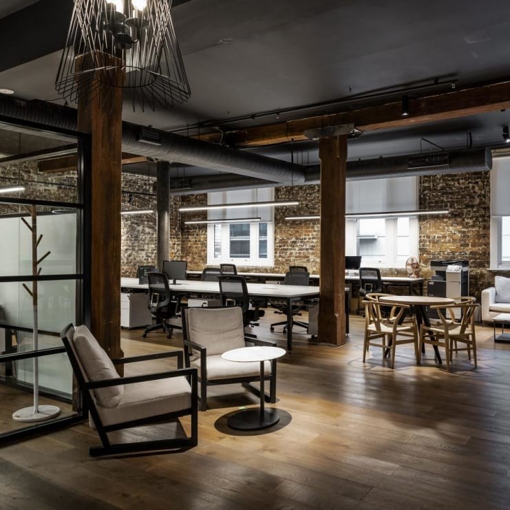 Desks in converted warehouse space