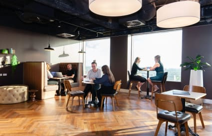 External 6-person collaborative workspace based with views of Adelaide's skyline