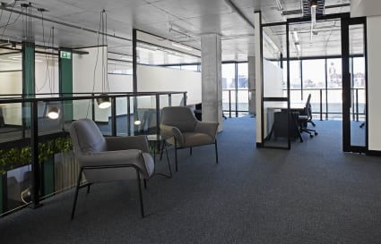 Open shared office spaces with large window with views out over Richmond