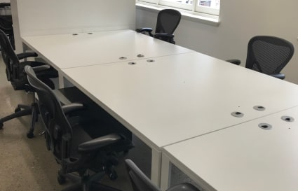 Block of 4 desks in semi private space