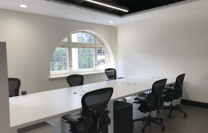 Up to 10 desks for small teams in semi private space