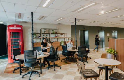 Collaborative 12-person workspace with views over the Parramatta CBD