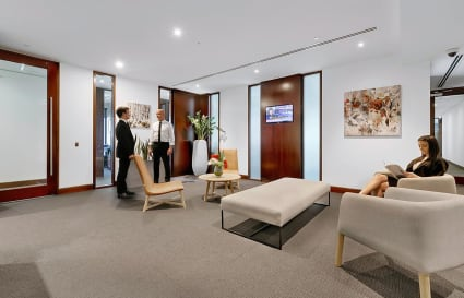 Beautifully appointed corner office suite with floor to ceiling views overlooking Brisbane river