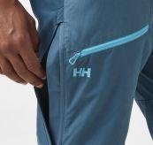 Verglas Tur Pant fra Helly Hansen til herre i fargen North Teal. Bildet viser luftedetalj på siden av lommen