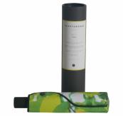 Paraply fra Happysweeds i designet lemon. Bildet er av paraplyen pakket i oppbevaringspose og esken som følger med