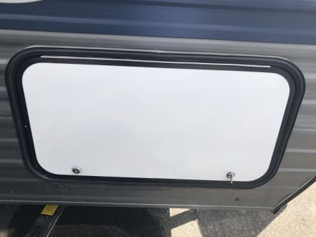 RV top hinge outside storage compartment door
