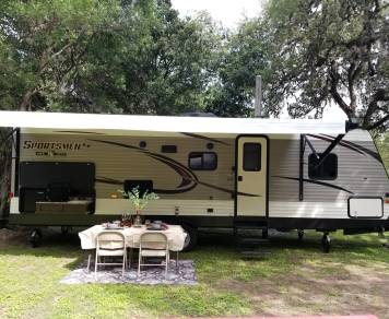 2018 Sportsmen, Escapade with Netflix,Hulu, Kuerig coffee machine,USB ports,BLU tooth speakers inside/outside,outdoor kitchen with table and four chairs, too many freebies to list.Scroll through our page and save $.