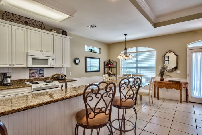 Large kitchen with eat-in counter and dining area