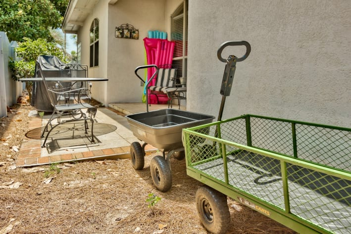 Outdoor patio with furniture, cart included for carrying items to the beach