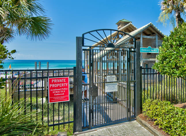 Private beach pavilion entrance with showers, rest rooms, rinse showers, wagon parking and  food bar during peak time
