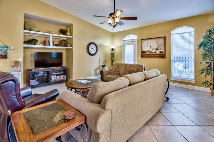 Large roomy family room with big screen TV