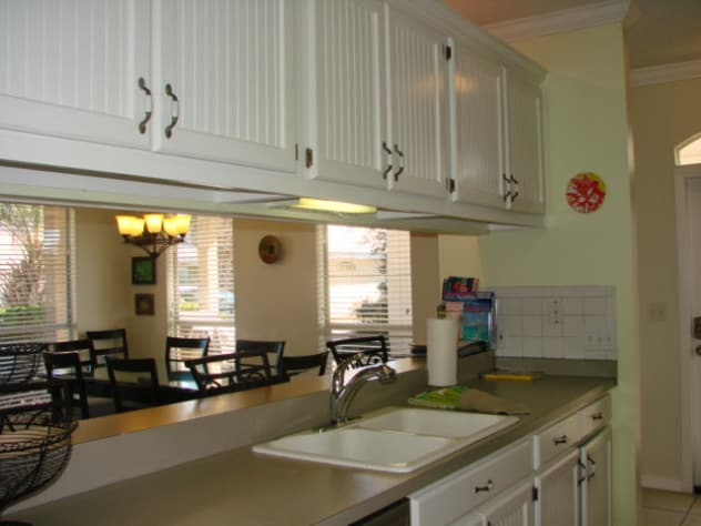 galley style kitchen is open to the living area
