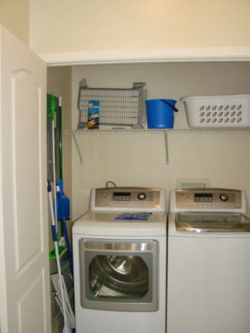 full size high efficency washer and dryer located next to the guest half bath ( not pictured )