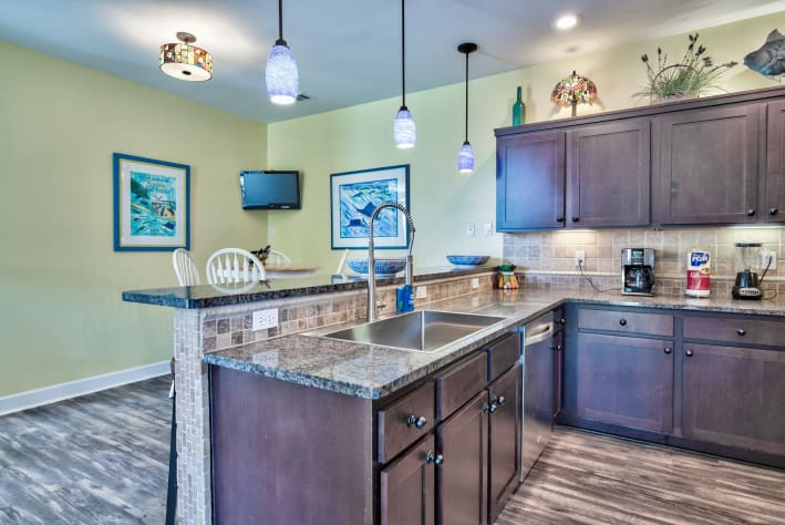 Eat-in Kitchen, granite counters, stone backsplash, zero radius sink, NOLA commercial faucet and stainless appliances