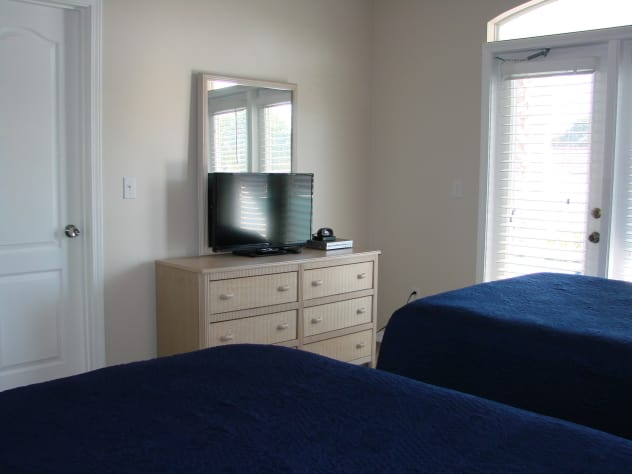 Upstairs guest bedroom also has access to balcony and large flat screen tv