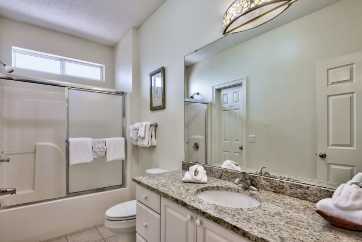 Guest bathroom with granite countertop.
