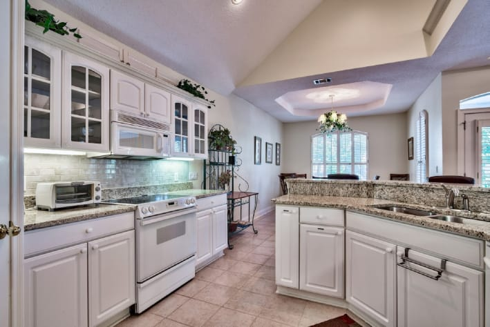 Eat-in kitchen with updated appliances.
