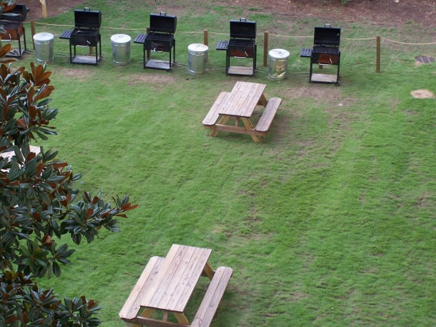 charcoal grills and picnic tables