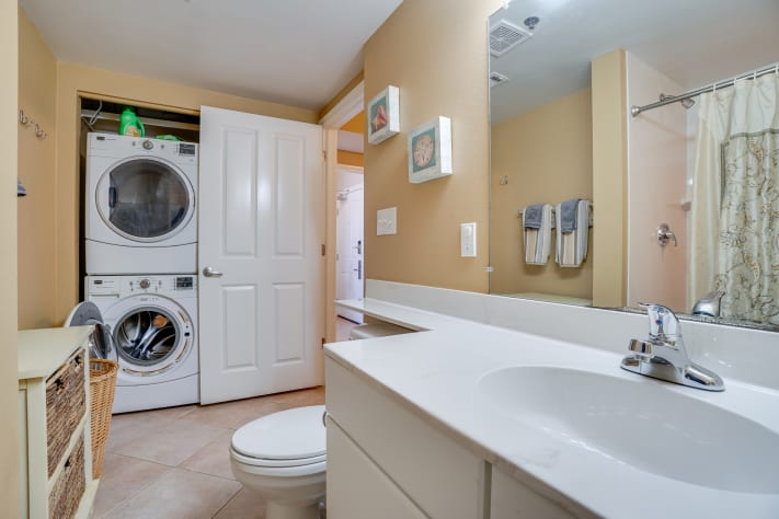 guest bathroom with full size washer and dryer