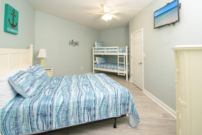 Queen bedroom with a set of bunkbeds
