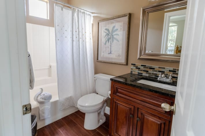 First floor full master bath attached to the king master bedroom, tub/shower