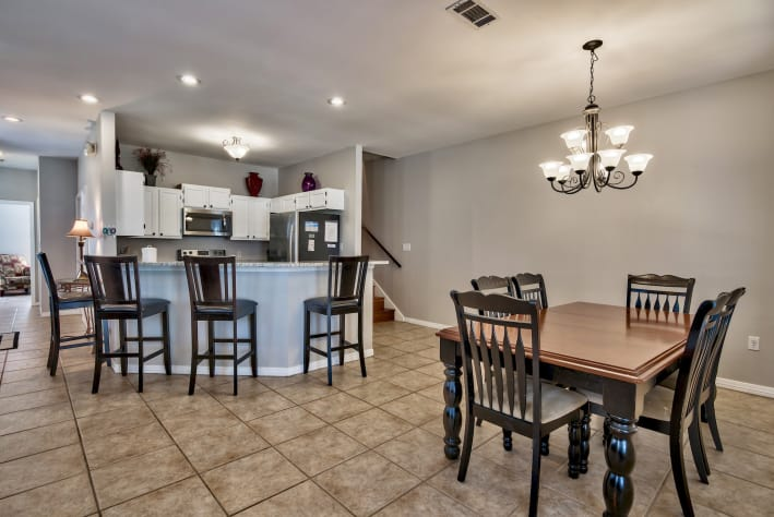 Dining Area with Seating For 6 and Additional Breakfast Bar Seating