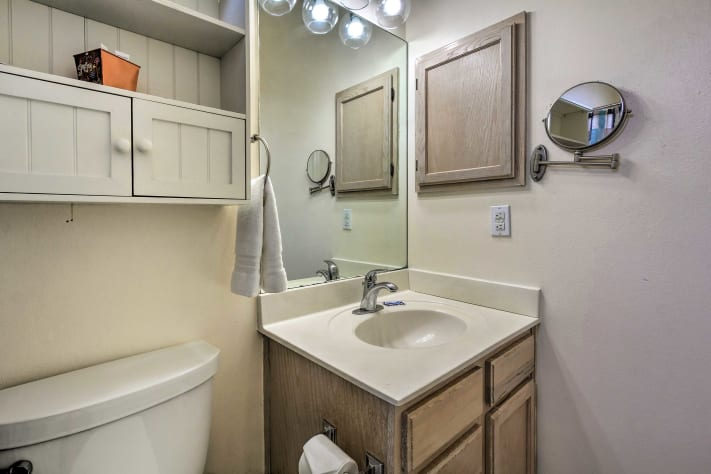 Attached master bath with tub and shower