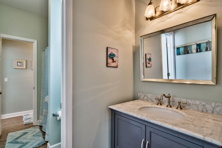 Jack N Jill bathroom with private vanities and shared shower area