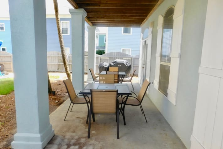 First Floor Additional Covered Patio Accessible from Living Area & King bedroom