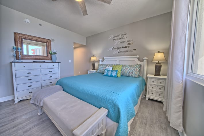 Master bedroom is cozy and has lots of storage.
