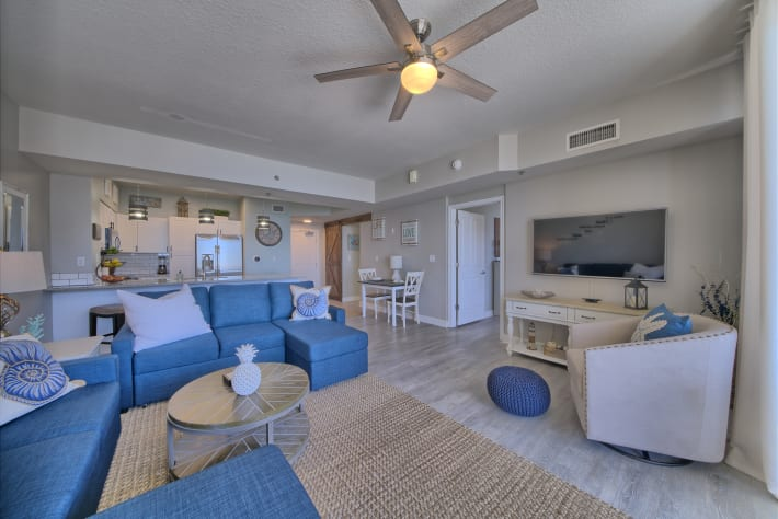 Spacious living room with a queen sleeper sofa and entertainment center.
